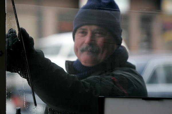 Peabody: Mike Kozwich of Bay State Cleaning braved the frigid temperatures to clean storefront windows on Main Street in Peabody yesterday. Photo by Deborah Parker/Salem News Thursday, January 15, 2009.