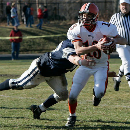 Hamilton: Ipswich's Sean McHugh looks to escape the tackle by a Hamilton-Wenham defender during Thursday's Thanksgiving Day football game at Hamilton. Photo by Deborah Parker/Salem News Thursday, November 27, 2008.