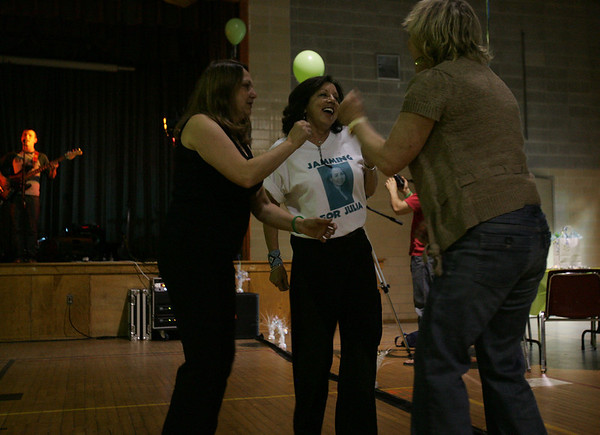 Marie Gauthier, mother of Julie Gauthier, a Salem teen who died in a car accident in March dances with family friends, Jean Martin and Peggy O'Toole, both from Salem during a benefit concert to help raise funds for a scholarship started in Julia's honor. Photo by Deborah Parker/may 7, 2010
