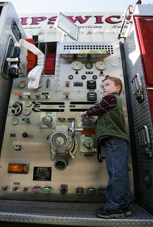 Dougie Aylward, 4, of Rowley, examines the controls on the side of a fire truck while at the Ipswich Fire Station during their open house Saturday morning. Photo by Deborah Parker/October 9, 2010