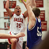 Salem's Dario Medrano is defended in front of the hoop by Danvers' Brad LeBlank durng last night's game held at Salem High School. Photo by Deborah Parker/January 25, 2009