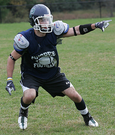 Pingree's John St. Pierre yells out instructions during a drill at practice Thursday afternoon. Photo by Deborah Parker/October 22, 2009