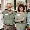 From left, Ken Gurley  of Landry and Arcari, Rinus Oosthoek, executive director of the Salem Chamber of Commerce, Brewer Dovan of Salem State and Robert DeRosier of Dominion Energy attend Chamber After Hours, a Salem Chamber of Commerce networking event held at Caffe Graziani Thursday evening. Photo by Deborah Parker/August 20, 2009