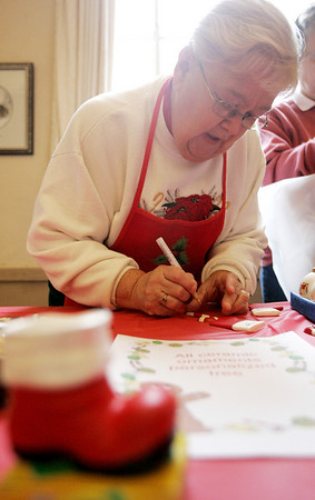 Beverly : Jinny Levoie, a long time parishioner of St. Peter's Episcopal Church, personalizes an ornament for a customer during the church's Holiday Extravaganza Saturday. The event included, a raffle, along with several tables with crafts and food items to purchase. Photo by Deborah Parker/Salem News Saturday, November 15, 2008