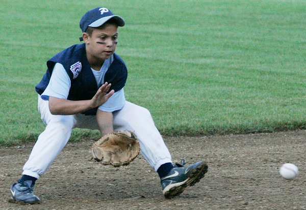 Peabody National's Christian Morales fields a ball during yesterday's game against Danvers American at Harry Ball Field in Beverly. Photo by Deborah Parker/July 9, 2009