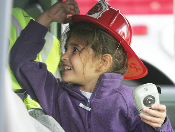 Cali Abbatessa, 5, of Danvers explores the front seat of an ambulance while at the Danvers Fire Departmen Fire Safety open house Thursday evening. Photo by Deborah Parker/October 8, 2009