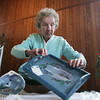 Joyce Bray, chairman of the 75th annual Guild of Beverly Artists holiday show, sets up a table while at the Lynch Park Carriage house Tuesday morning. photo by deborah parker/november 30, 2010