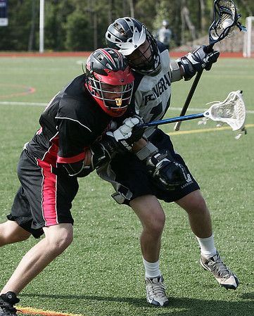 Wenham: Hamilton-Wenham's Zach Gaucher is defended by North Andover's Shane Wescott during their game held at Gordon College Friday afternoon. Photo  by Deborah Parker/May 8, 2009
