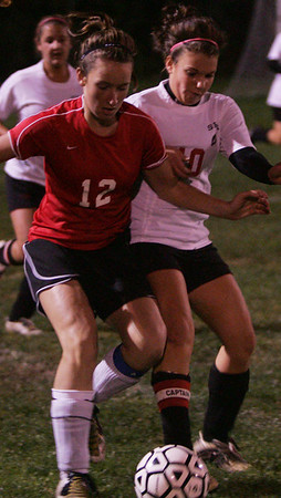 Marblehead's Meggie Collins fights for control of the ball over Salem's Ashley Maccario during last night's game held at Bertram Field in Salem. Photo by Deborah Parker/October 7, 2009