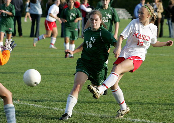 Lucy Gildein scores against Manchester Essex's Rebecca Lynch during Tuesday's game at held at Masco. Lucy will be going to play Division 1 soccer in college on scholarship. Photo by Deborah Parker/October 20, 2009