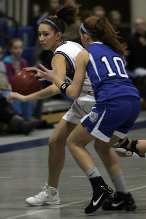 Peabody's Carissa Milley is defened by Wahconah Regional High School's Darcy Sullivan during last night's Tanner Cit Holiday Classic held at Peabody High School. Photo by Deborah Parker/December 29, 2009