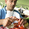 John Maihos of Beverly enjoys eating a lobster during the Lobster Festival at Lynch Park, part of Beverly Homecoming. Photo by Deborah Parker/August 5, 2009