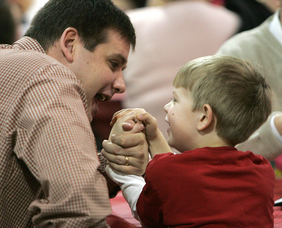 Mike Gergley of Peabody arm wrestles with his son, Andrew, 5, during a special Valentine's day brunch held at the McCarthy Elementary School Friday morning. Photo by Deborah Parker/February 12, 2010