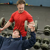 Topsfield: Matt Foley, owner of a sports and fitness conditioning gym on Route 1 in Tospfield, helps Nicholas Maddern, 23, of Hamilton perform a dumbell excersize while at the gym. Photo by Deborah Parker/Salem News Thursday, February 26, 2009.