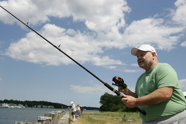 New England Homes for the Deaf resident Kevin Keefe casts off his fishing reel into the Danvers river off their Danversport property. Recently, a fishing club was started for the residents, that meets every Friday in coordination with the tide. Photo by Deborah Parker/July 30, 2010