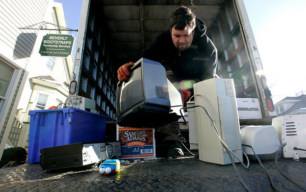 Beverly: Christopher Swain of Toxtour loads used electornics into the back of a truck Saturday morning during Beverly Bootstraps' Ethical Electornics Recycling Benefit Event. With the help of Toxtour Bootstraps collected used electronics to be recycled ethically with nothing being put into landfills, incinerated as solid waste or dumped into developing countries. Photo by Deborah Parker/Salem News Saturday, January 24, 2009.