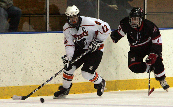 Beverly's Tyler Albano is defended by Marblehead's Anders Gundersen during last night's game held at Salem State College. Photo by Deborah Parker/January 13, 2009