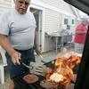 Dave Sullivan of Danvers tends to the grill during a bbq at the Bass Haven Yacht Club in Beverly in honor of its 100th anniversary Thursday evening. Photo by Deborah Parker/July 2, 2010