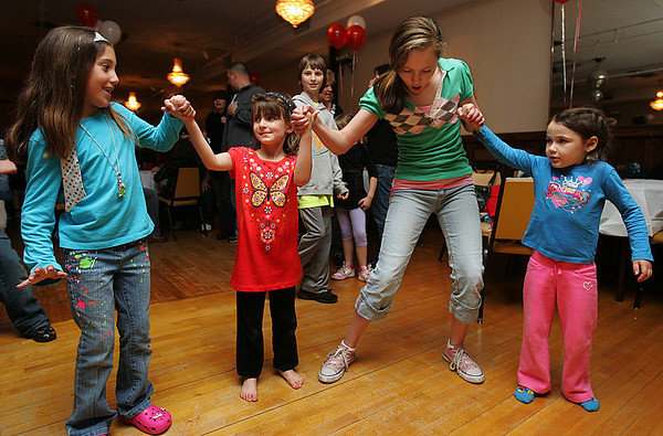 "From left, Tory Shea, 7, Nikki Erricola, 5, Mackenzie Mason, 13 and Skyler Corelli, 5, all of Beverly, dance together during ""Ciao Centerville, Chow Pizza"" a fundraiser for the Centerville PTO held at the Vittori Rocci Post Friday evening. Photo by Deborah Parker/April 9, 2010"