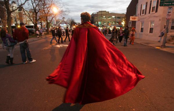 A Halloween reveler walks down the road near Congress and Derby Street during Halloween evening. Photo by Deborah Parker/October 31, 2009