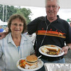Fran and Bob McLaughlin of Peabody attend a bbq at the Bass Haven Yacht Club in Beverly in honor of its 100th anniversary Thursday evening. Photo by Deborah Parker/July 2, 2010