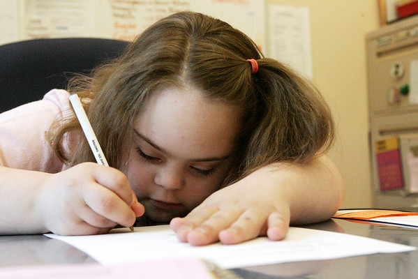 Peabody: Jillian Spinale, 10, a fourth grader at Brown Elementary School signs a teacher evaluation sheet, one of the many tasks she accomplished as Principal for Day on Wednesday.<br /> Photo by Deborah Parker/May 27, 2009