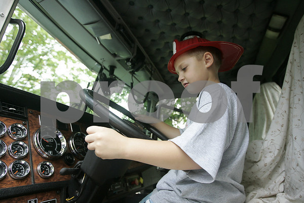 Danvers: Thomas Smales, 6, of Danvers pretends to shift while exploring a trailer truck during Truck Day at Endicott Park Saturday. The event, which was sposered by the town Recreation Department featured vehicles covering police motorcycles to school buses, to cement trucks.<br /> Photo by Deborah Parker/Salem News Saturday, September 13, 2008
