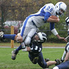 Swampscott's Jake McDougall brings down Danvers' Clinton Lutz during Saturday's game held at Swampscott. Photo by Deborah Parker/October 24, 2009