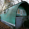 Richard Symmes, Beverly historian and co-founder of the Walker Transportation Collection is trying to save this Quonset Hut in Hamilton. The home is an original Quonset Hut, which were built during and after World War II for housing, storage, etc. This hut was from a Quonset Hut Village off of Cabot Street. Photo by Deborah Parker/November 6, 2009