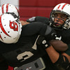 Salem's Josh Sanchez defends his teammate Derek MacIntire during practice Wednesday afternoon in preperation for Friday's game against Peabody. Photo by Deborah Parker/October 28, 2009