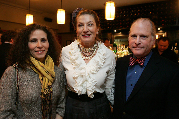 From left, Angela Cardona from Manchester by the Sea, Octavia Randolph and her husband Jonathan Gilman of Nahant pose for a picture while attending a cocktail reception at Sixty2 on the Wharf to kick off the bicentennial year of the Salem Athenaeum. Photo by Deborah Parker/January 12, 2009.