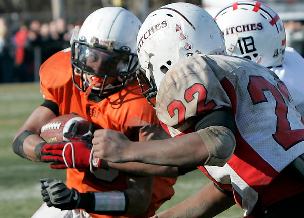 Beverly: Beverly's Rashad Sims looks to escape the a tackle by Salem's  Davis Kendrick during Thursday's Thanksgiving Day game held at Hurd Stadium. Photo by Deborah Parker/Salem News Thursday, November 27, 2008.