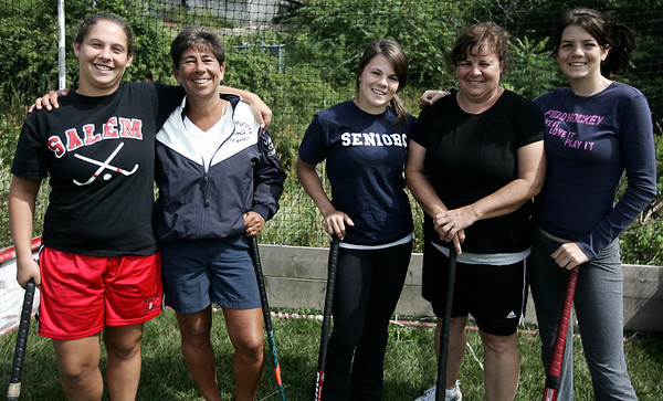 Swampscott field hockey coach, Toby Channen, along with Salem field hockey coach, Holly Sheehan, coach each other daughter's. Channen's daughter, Rachel plays for Salem while Sheehan's daugthers, Kaitlyn and Melissa Englehardt, play for Swampscott. Photo by Deborah Parker/Septmeber 7, 2009