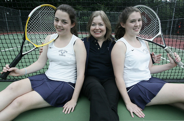Sisters, Sarah, left, and Allison Connors are both coached by their mom Nancy Connors at Pope John High School in Everett. Photo by Deborah Parker/June 30, 2009