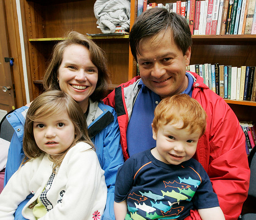 """The Potts Family, Anne and George of Swampscott (did not want to give their children's names) enjoy the """"Pirates Night"""" family night program at the Swampscott Library Tuesday. The event included live pirate performers along with a temporary tattoo to wear through the evening. Photo by Deborah Parker/July 7, 2009."""