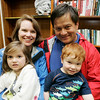 "The Potts Family, Anne and George of Swampscott (did not want to give their children's names) enjoy the ""Pirates Night"" family night program at the Swampscott Library Tuesday. The event included live pirate performers along with a temporary tattoo to wear through the evening. Photo by Deborah Parker/July 7, 2009."