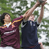 St. John's Christian Gutowski and Boston College High's Tom Thekaekara fight for control of the ball during yesterday's rugby match held at St. John's Prep. Photo by Deborah Parker/May 18, 2010