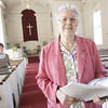 Salem: Catherine Piemonte, longtime member of the Tabernacle Church, has recently written a 300-page history book on the old church. Behind Piemonte is church Reverand Laura Biddle. Photo by Deborah Parker/Salem News Thursday, October 09, 2008