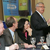 From left, Beverly Mayor Bill Scanlon, Danvers Town Manager Wayne Marquis and Salem Mayor Kim Driscoll listen to Michael Bonfanti, mayor of Peabody as he speaks about the challenages and opportunites in Peabody during the North Shore Chamber of Commerce Business Expo held at the Crowne Plaza Boston North Shore. Photo by Deborah Parker/February ,23, 2010