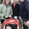 Beverly: From left, the O'Malley family, Tanya, Aidan, Meaghan and Midge, all of Beverly, gather at Veterans Park before starting the Beverly Magical History Tour, a historical scavenger hunt through downtown Beverly. The event was hosted by Beverly Main Streets. Photo by Deborah Parker/Salem News April 18, 2009.