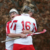 Masco's Pam Herter celebrates with teammate Julie Galvin after Masco scored in the second half of the state tournament game against Danvers Wednesday. Photo by Deborah Parker/November 4, 2009