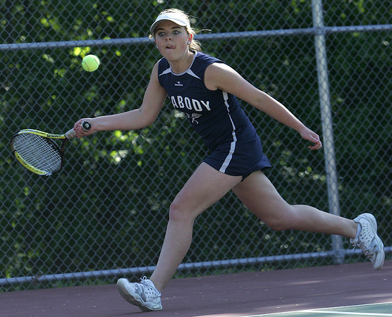 Peabody's Alaina Warren competes in first singles in yesterday's tennis match against Swampscott held in Peabody. Photo by Deborah Parker/May 21, 2010