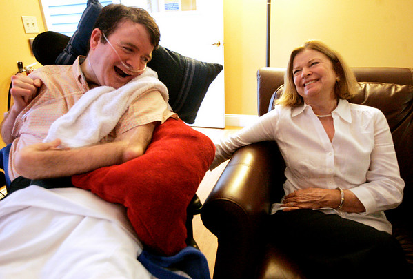 Jody Goldberg of Beverly Farms laughs with her son, Matthew, 38 while at Bridgewell, a new group home in Beverly. There are 5 men that range in age from 38 to 72, who have previously spend most of their adult lives in an institutional nursing home. Three are nonverbal inlcuding Matthew, who suffered brain damage from a motocycle accident when he was 21, and another man has cerebral palsy. Since coming to Bridgwell, they've had a much better quality of life. Photo by Deborah Parker/July 7, 2009