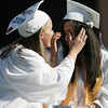 Peabody Veterans Memorial High School saluditorian Esty Yanco wipes away tears of classmate and senior class president, Anne Scotina, after Esty made a moving salutatory speech focusing on her late father during graduation Friday evening. Photo by Deborah Parker/June 12, 2009
