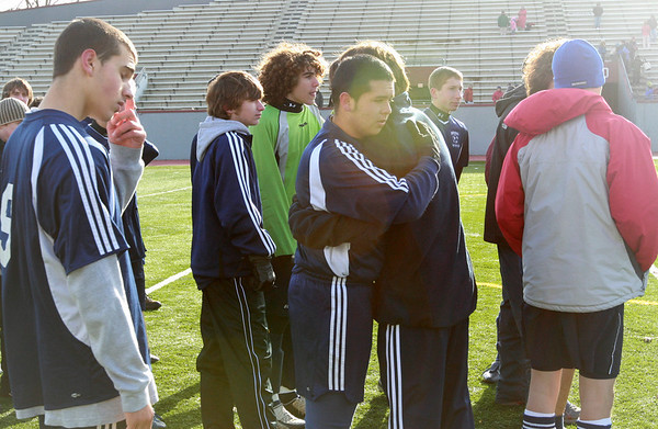 Lowell: The Hamilton-Wenham soccer team consoles one another after loosing in the Division 3 State Championship against Bromfield. Photo by Deborah Parker/Salem News Saturday November 22, 2008.