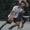 Beverly's Aven Jones is defended by Peabody's Kyle Boyce during Monday night's North Shore Summer League basketball game held at Plains Park in Danvers. Photo by Deborah Parker/August 2, 2010