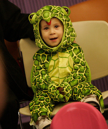 Peabody: Dressed as a turtle, Matthew Pace, 2, of Peabody listens as Officer Eon of the Peabody Police along gave a short presentation on Halloween safety during a Halloween Party at the Peabody Institue Library.  Photo by Deborah Parker/ Salem News Thursday, October 30, 2008.
