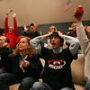 Close family friends of the Duggan family reaact while watching the Danvers' native Meghan Duggan on the big screen as she and the Women's USA hockey team competed against Canada for the gold in Vancouver. From left in front is Jim Hayes and Cheryl Marshall, both of Danvers and former coaches of Duggan along with Lous Hayes and Kevin Pydynkowski, also of Danvers. and Photo by Deborah Parker/February 25, 2010
