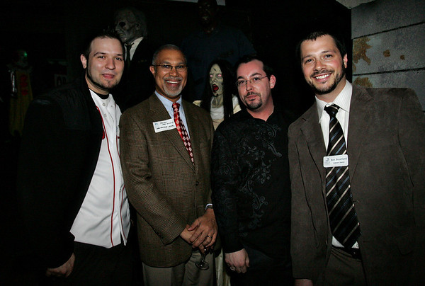 Joey Columba of Salem Fan page, Thomas Macdonald with the Hawthorne Hotel, James Lurgio with the Nightmare Gallery and Ben Bouchard with the Salem Chamber of Commerce attend the Chamber After Hours event at Count Orlok's Nightmare Gallery on Thursday evening. Photo by Deborah parker/april 22, 2010
