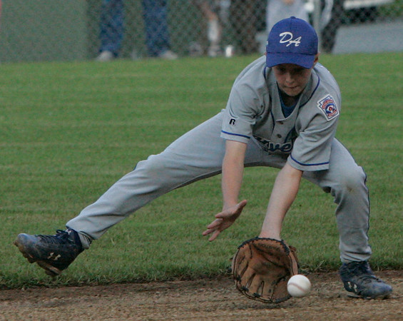 Danvers American's Mark Etherington fields a ball during yesterday's game against Peabody National at Harry Ball Field in Beverly. Photo by Deborah Parker/July 9, 2009
